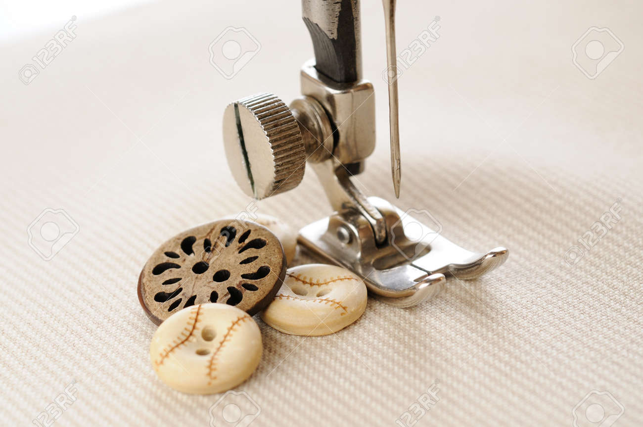 Needle of sewing machine with buttons and fabric Stock Photo - 15659661
