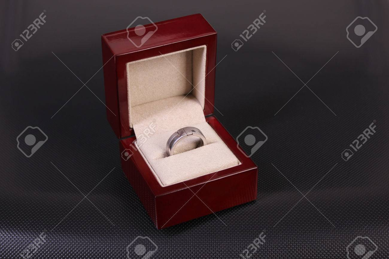 Men S Silver Ring And White Gold And Diamond In A Box On A Dark Background