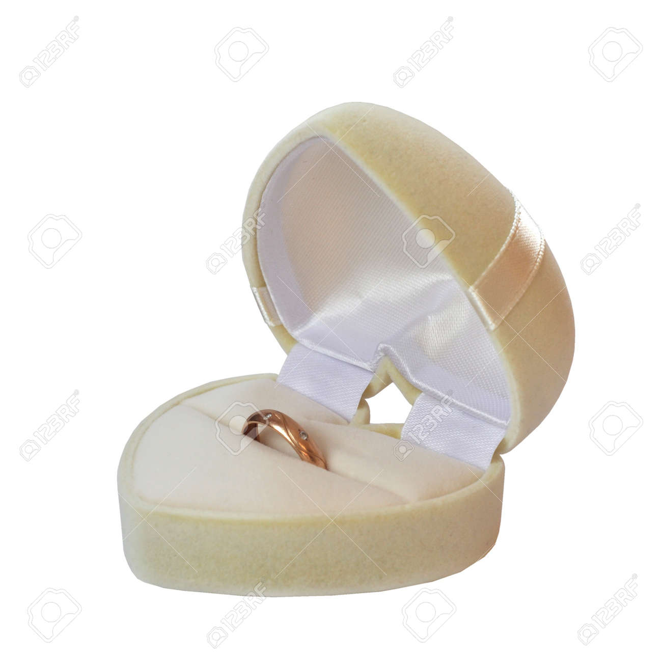 Box in the form of a white heart with wedding ring isolated on white background Stock Photo - 16142481