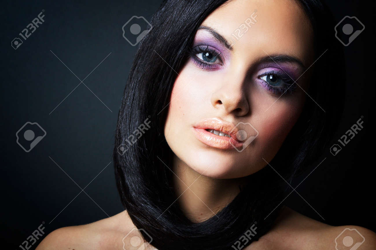 Fashion girl posing on dark background - portrait Stock Photo - 3445300