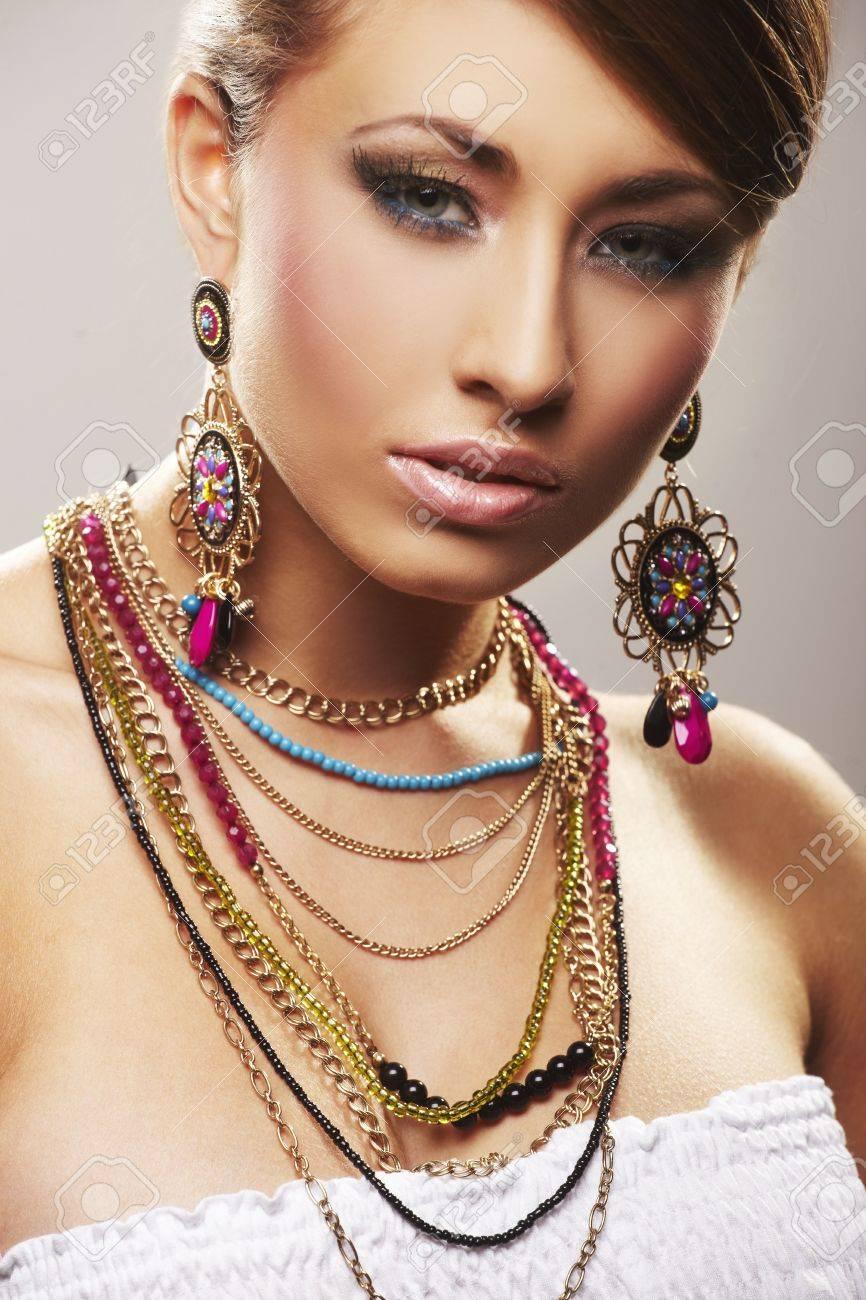 fashion woman with jewelry on light bacground Stock Photo - 5680376