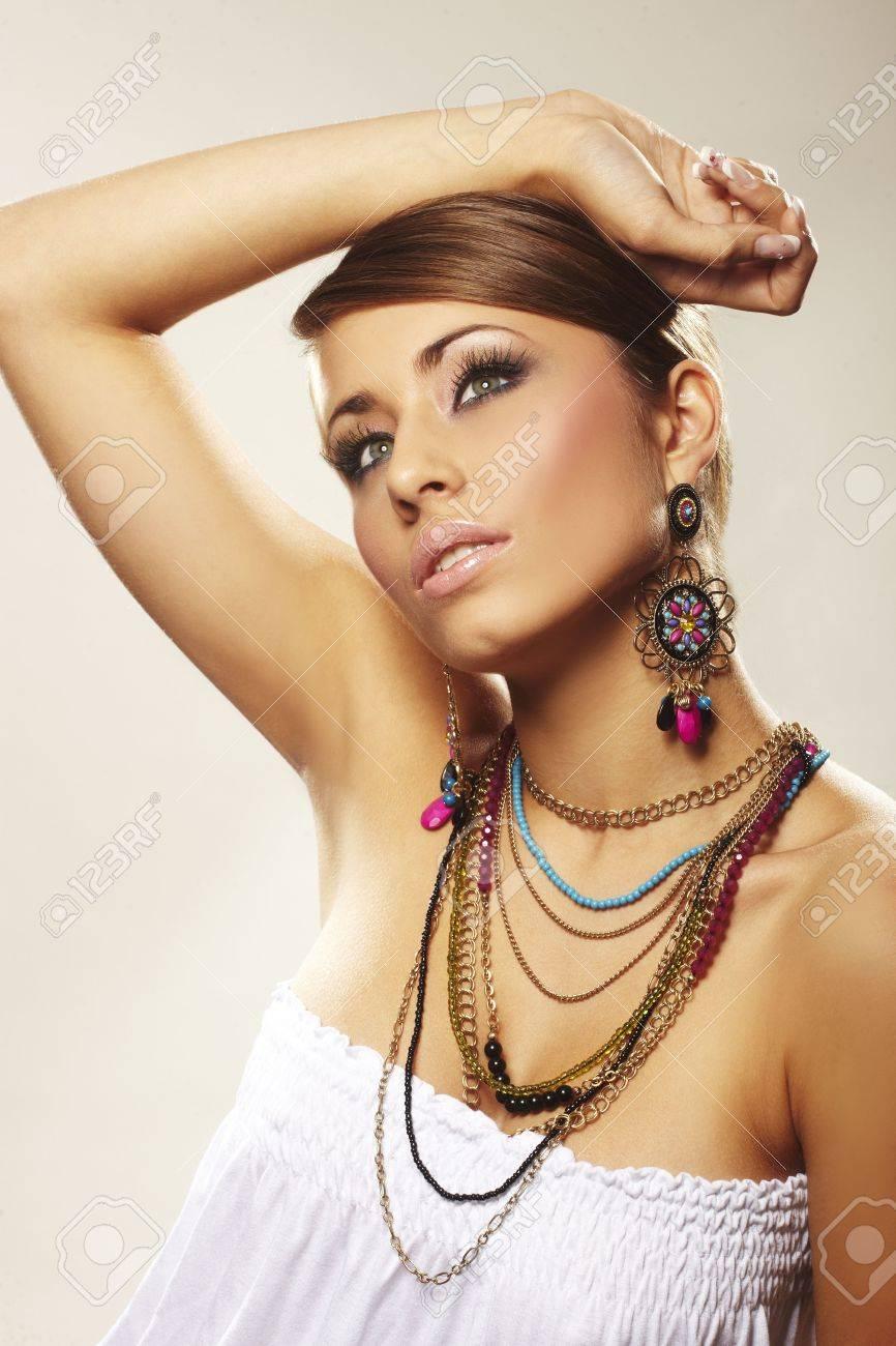 fashion woman with jewelry on light bacground Stock Photo - 5721540