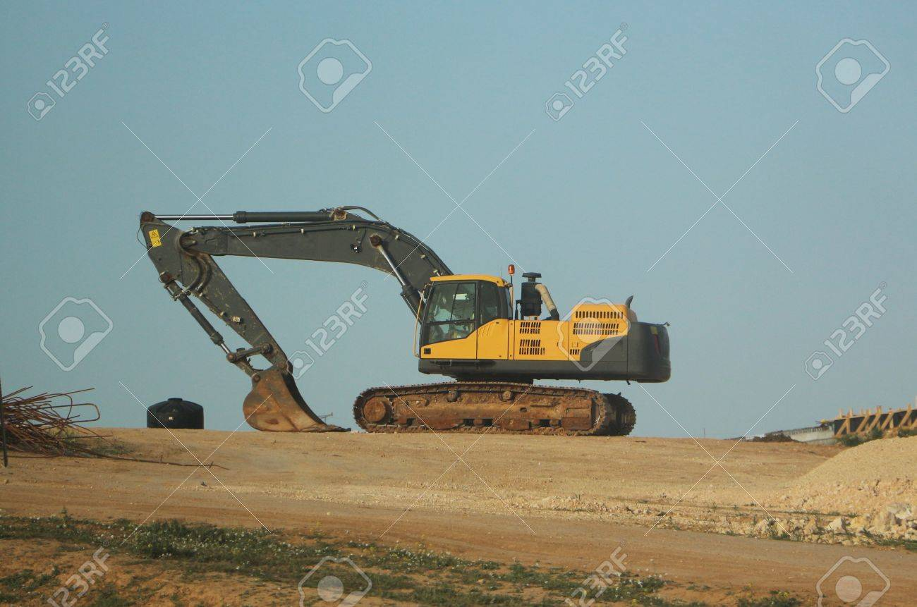 Large Excavator Or Earth Moving Equipment Standing On The Brow