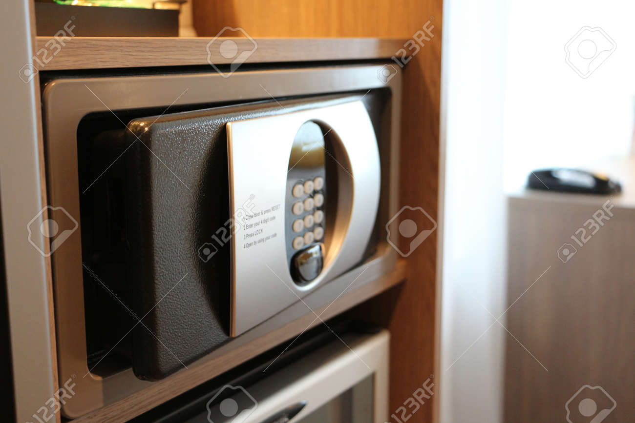 Oblique view over slightly opened safe for personal belongings - 20724038