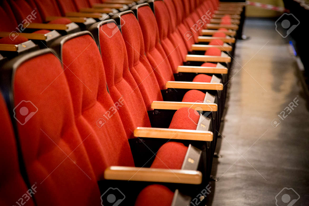 Oblique view over a row of red theatre seats at a movie theatre oblique view over a row of red theatre seats at a movie theatre stock photo freerunsca Gallery