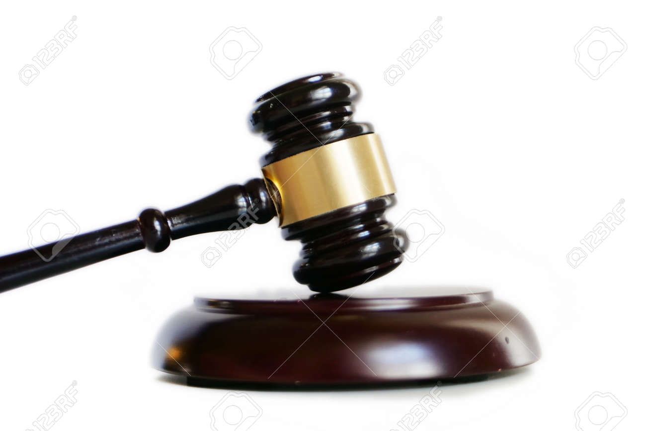 Court gavel used by judge lay on white surface side view - 149643484