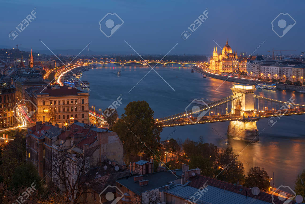 Scenic view of Budapest city at blue hour with illuminated Chain Bridge, Hungarian Parliament, Margaret Bridge and Danube embankment. Picturesque evening cityscape. - 120093032