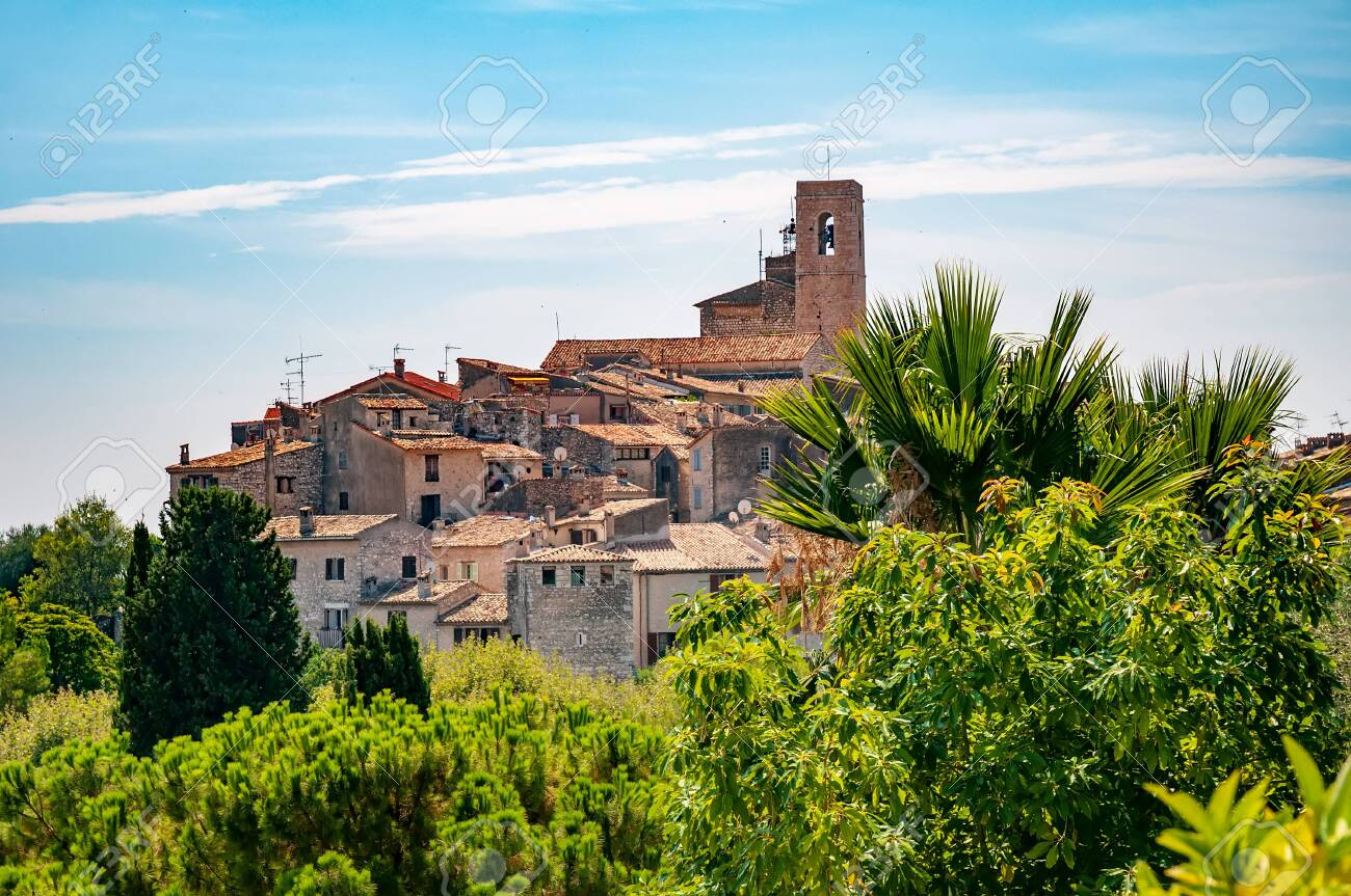 Panoramic view of Saint-Paul-de-Vence town in Provence, France. It is a medieval village, popular tourist attraction known as 'village perches' (village-fortress) and town of arts - 129153206