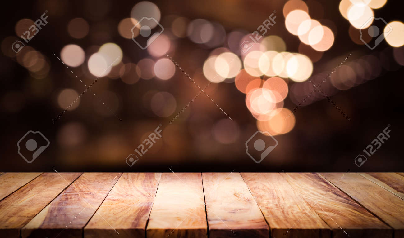 Wood table top with blur light bokeh in dark night cafe,restaurant background .Lifestyle and celebration concepts - 119293001