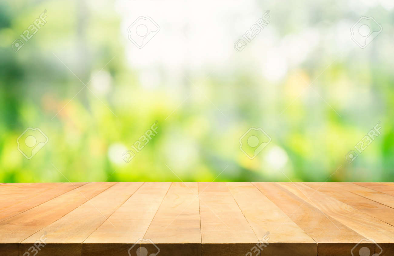 Empty of wood table top on blur of fresh green abstract background .For montage product display or design key visual layout - 126424505