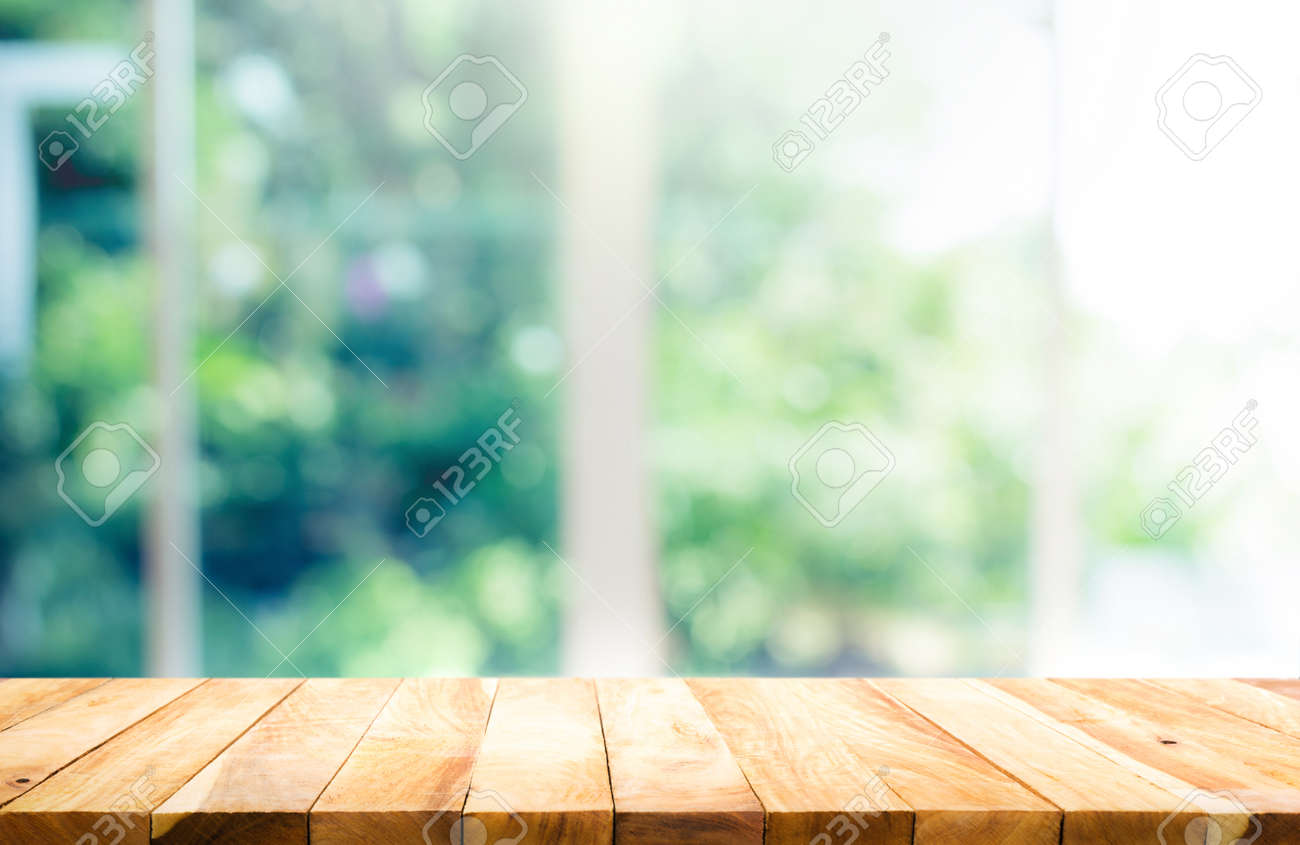 Wood table top on blur of window with garden flower background in morning.For montage product display or design key visual layout - 126426721