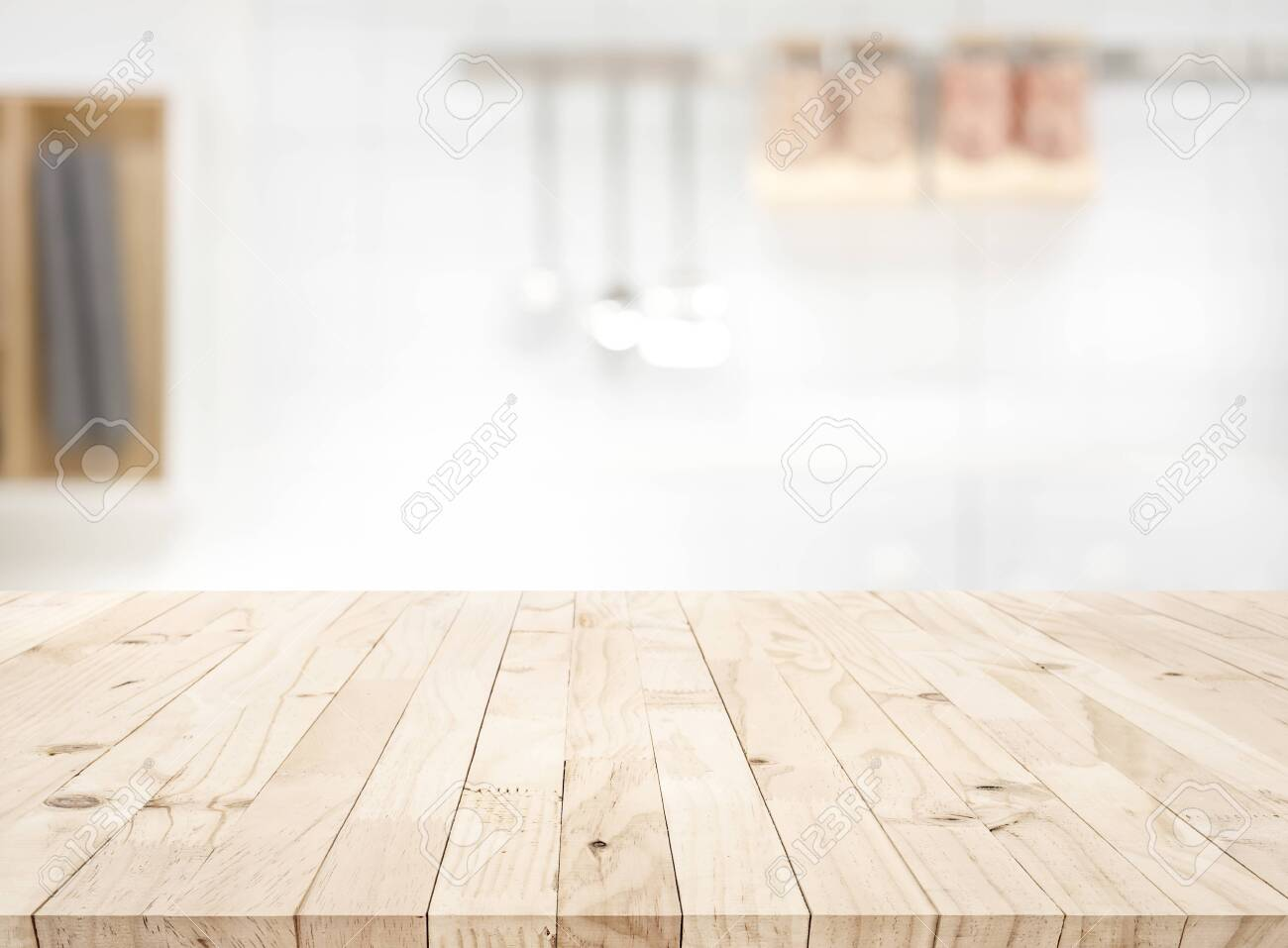 Wood table top on blur kitchen counter roombackground.For montage..