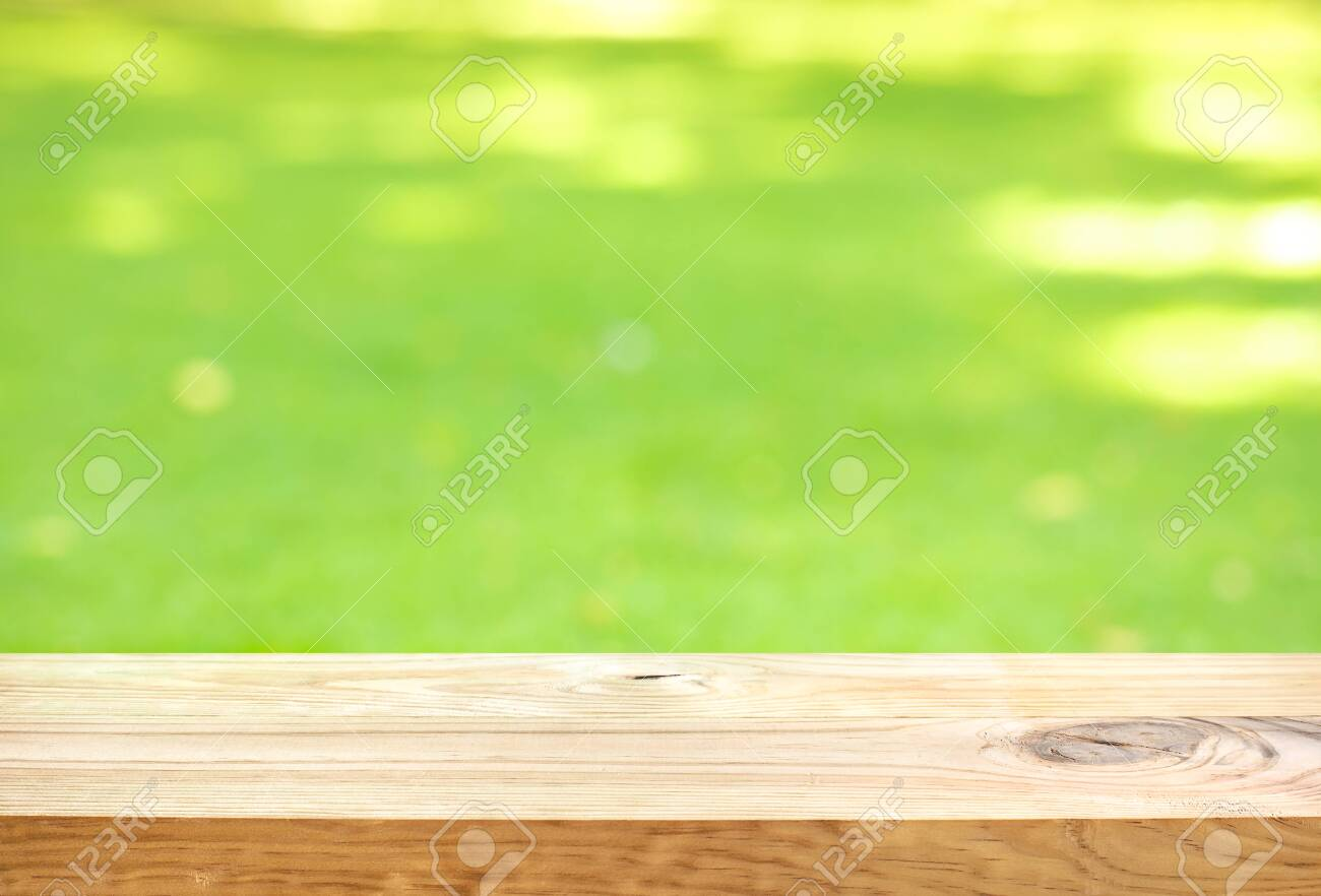 Blank wood board with blur green courtyard background.Summer and picnic concepts.Design for key visual food and drink products - 152568259