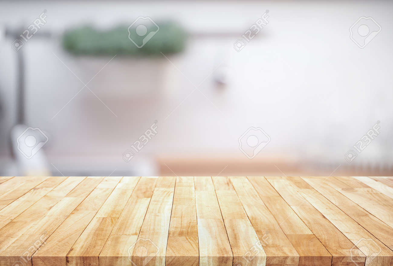 Wood table top on blur kitchen counter (room)background.For montage product display or design key visual layout. - 154855067