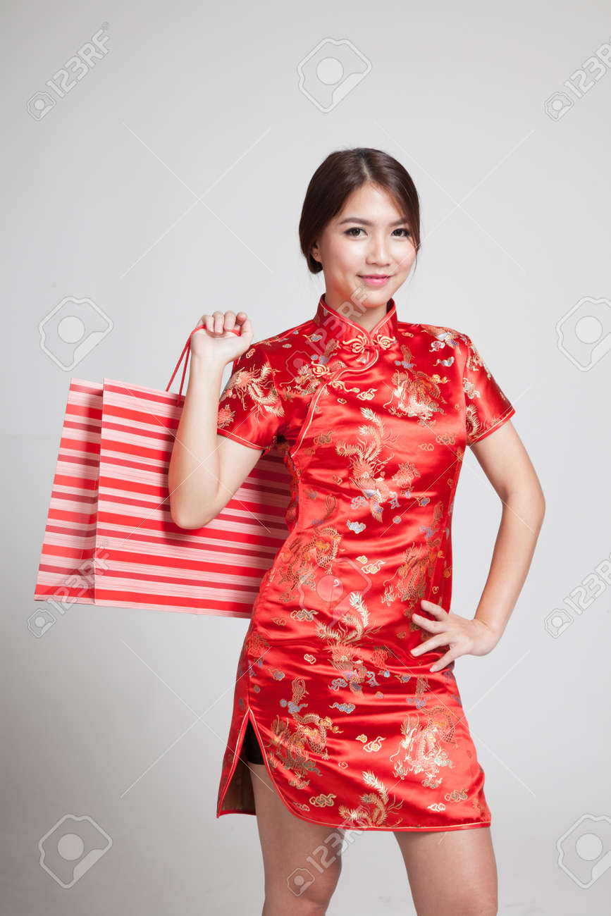 b16316a5a5 Asian girl in chinese cheongsam dress on gray background Stock Photo -  56170612