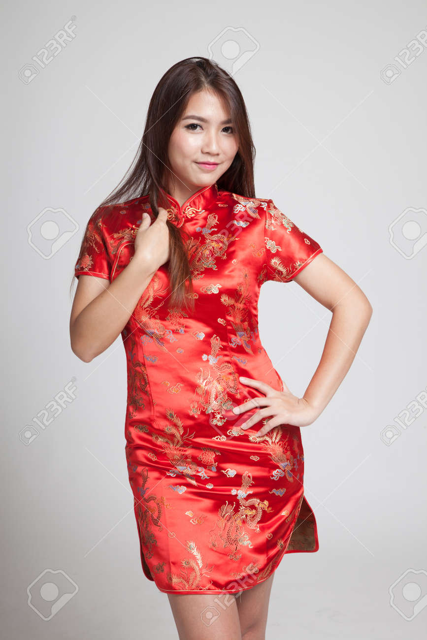 418a657b8e Asian girl in chinese cheongsam dress on gray background Stock Photo -  56170667