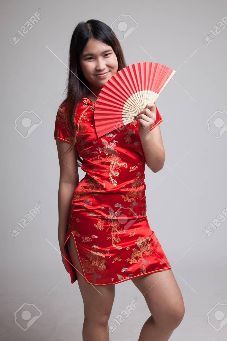 fcf90f3b92 Asian girl in chinese cheongsam dress on gray background Stock Photo -  87183092