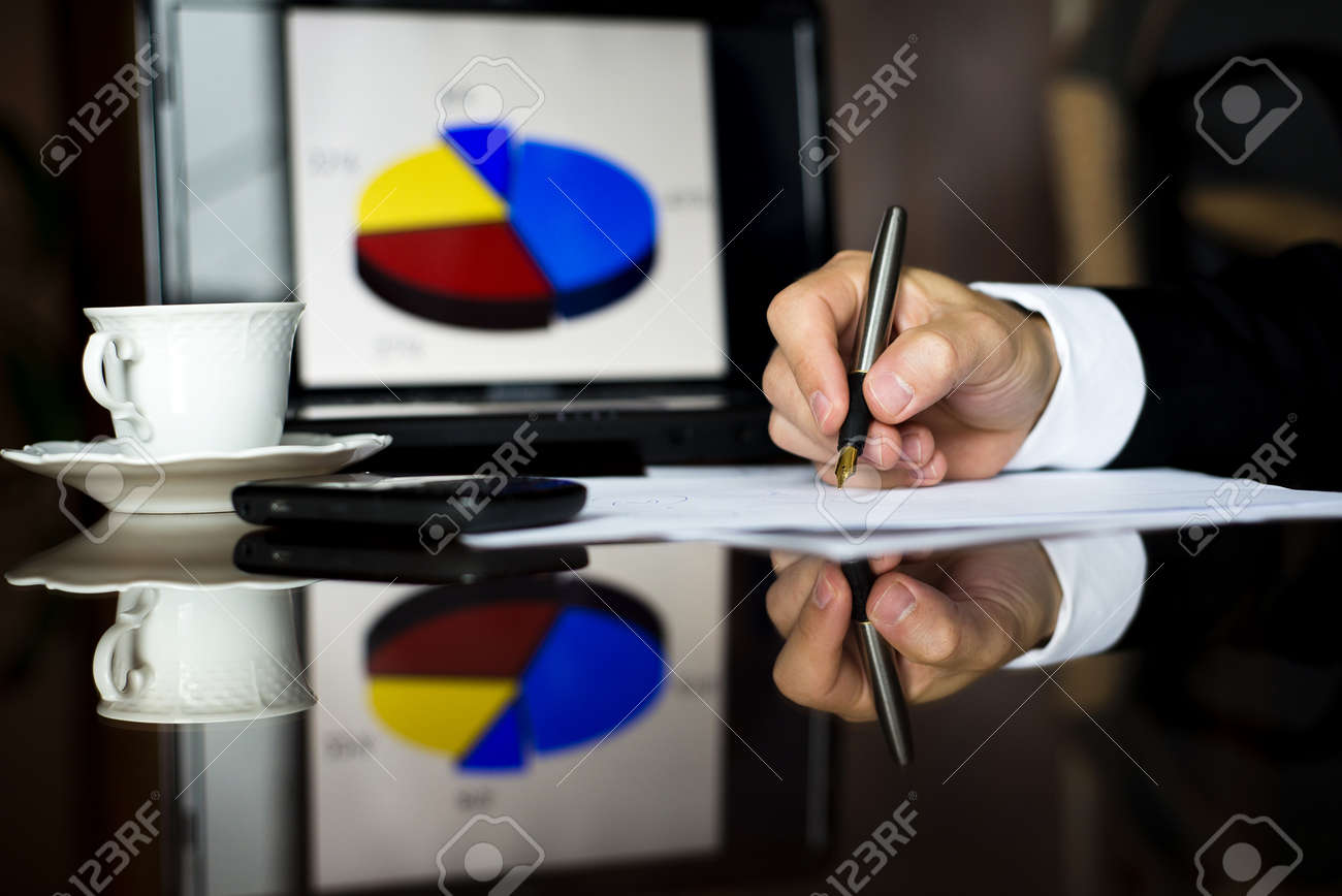 Businessman is writing report on the office desk Stock Photo - 16873844