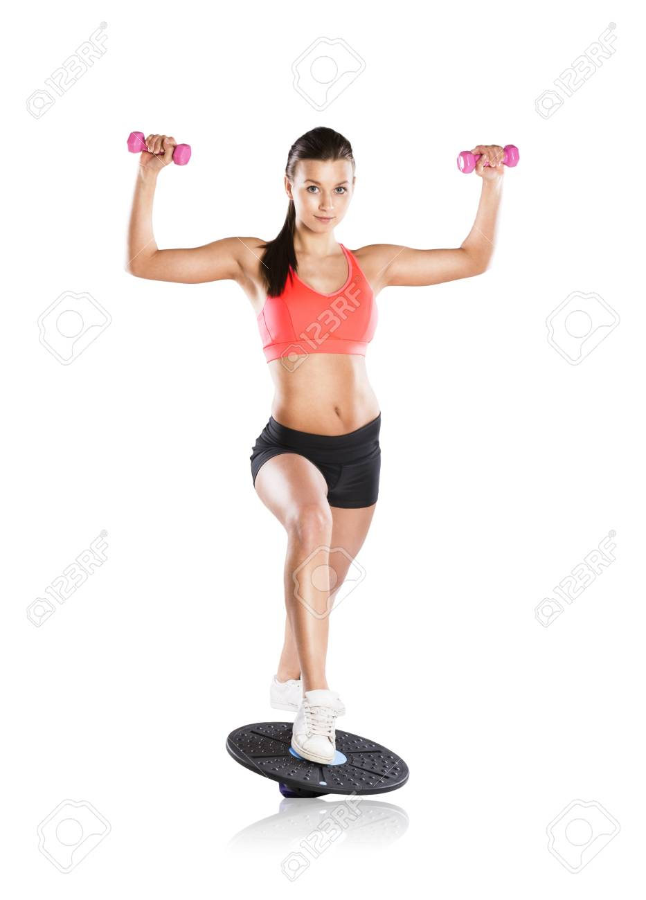 Young beautiful model with fitness balance board Stock Photo - 18344595