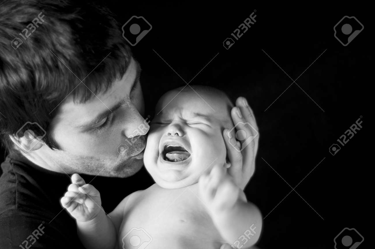 Young father with his crying baby in studio Stock Photo - 18916182