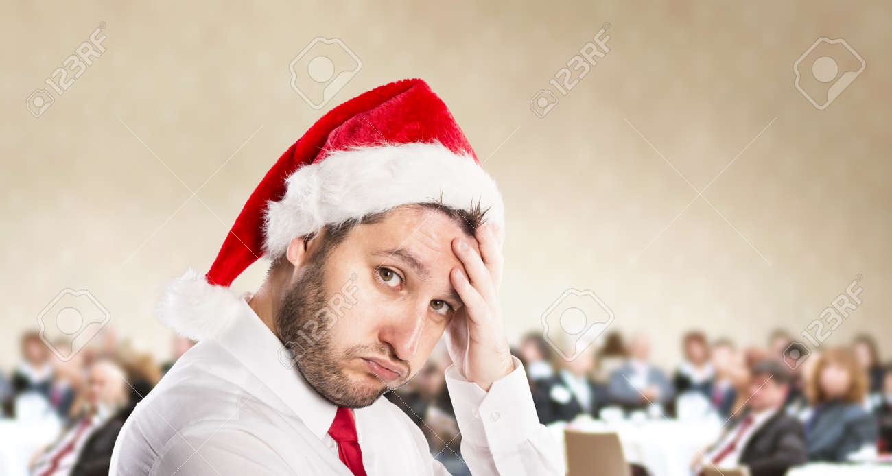 Funny businessman with christmas cap is on conference Stock Photo - 22661557