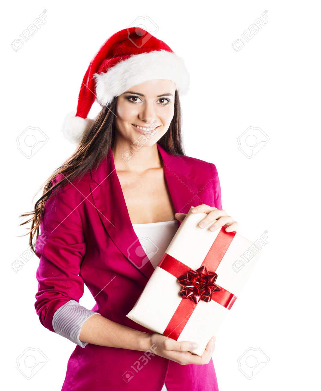 Beautiful woman with christmas hat is holding gift  Isolated on white background Stock Photo - 23122720