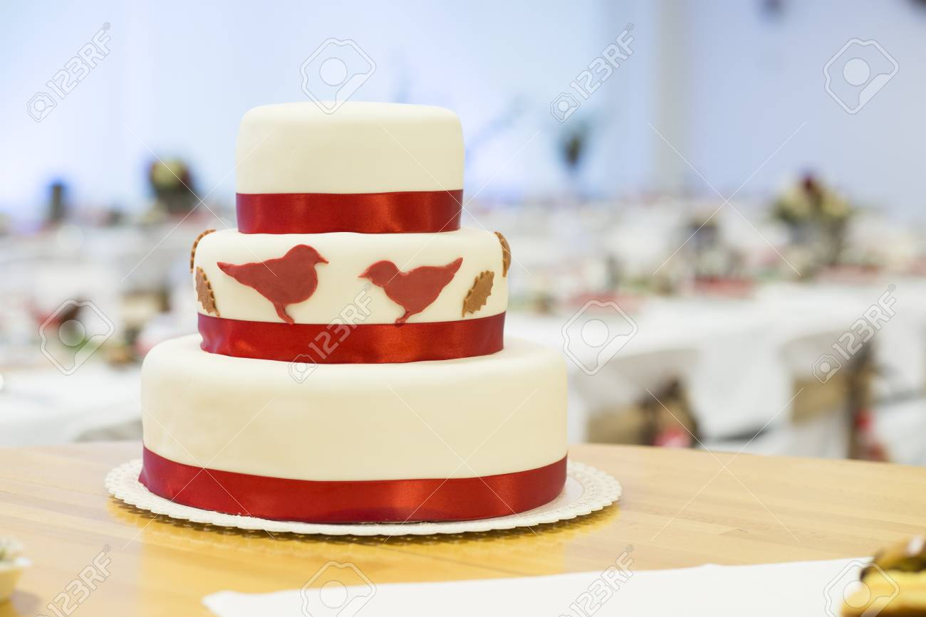 Beautiful And Tasty Wedding Cake At Reception Stock Photo