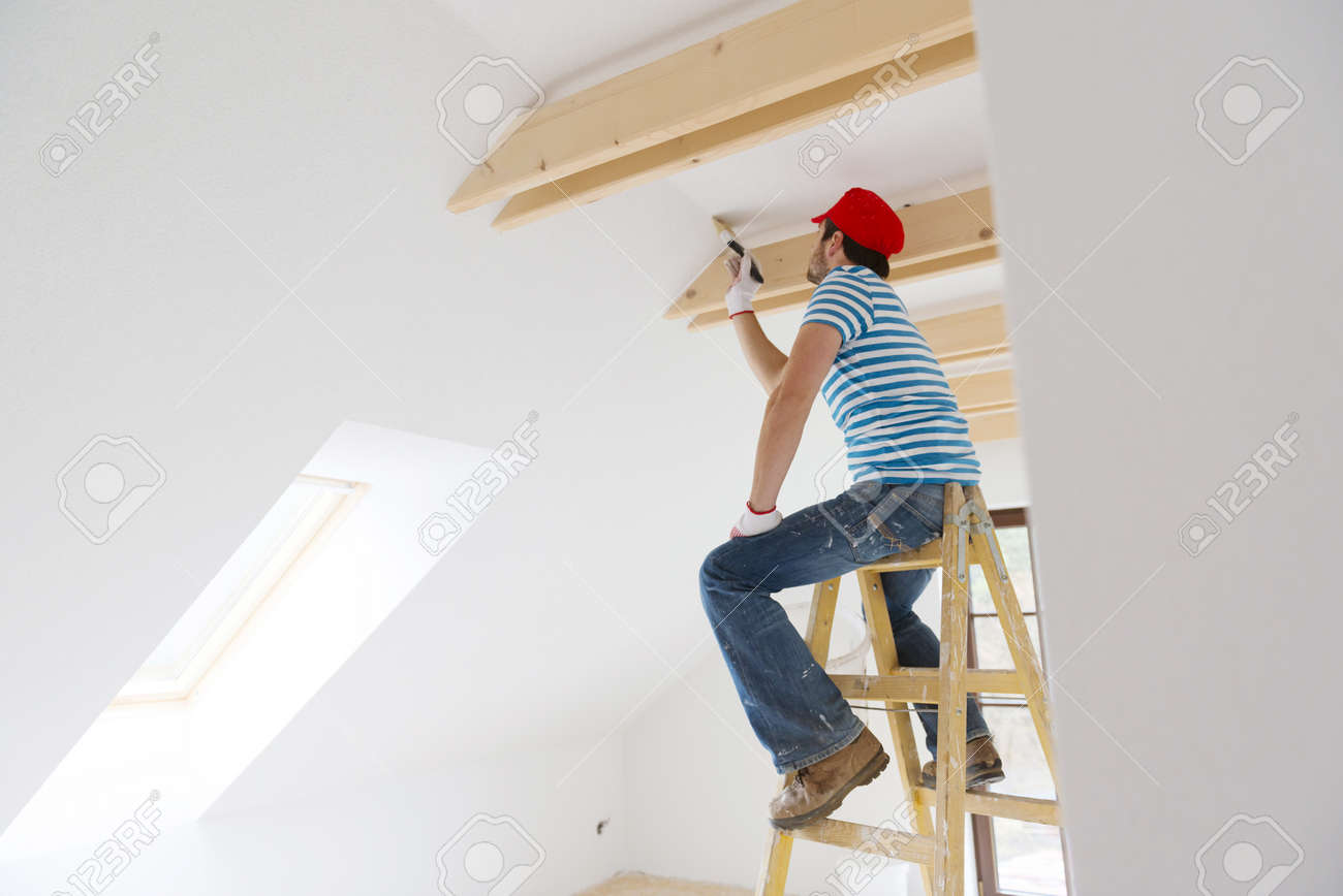 Person painting wall - Man Painting Wall In New House Stock Photo 27824491