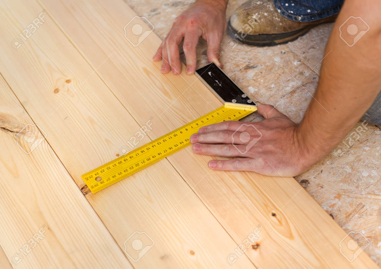 Close Up Of Male Hands Measuring Wood Flooring Stock Photo 29021512