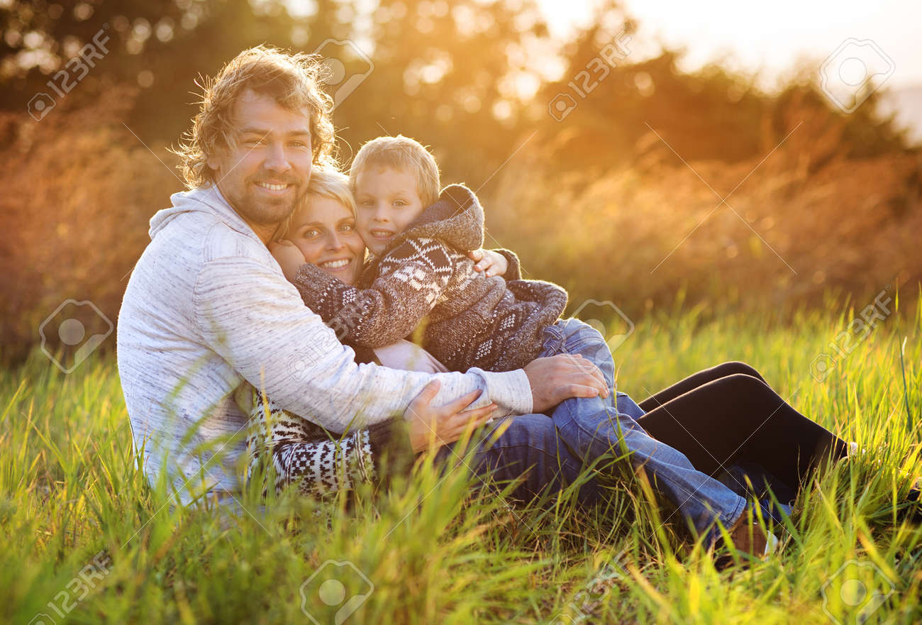 Happy young family spending time together outside in green nature. - 36097188