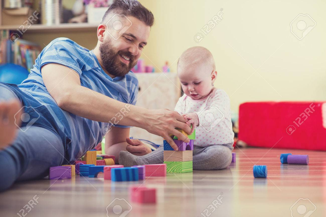 Young hipster father playing with his daughter Stock Photo - 39977323