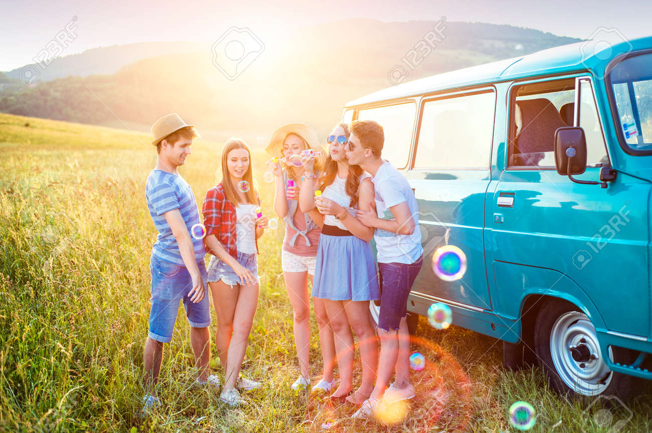 Young hipster friends on road trip on a summer day - 45596041