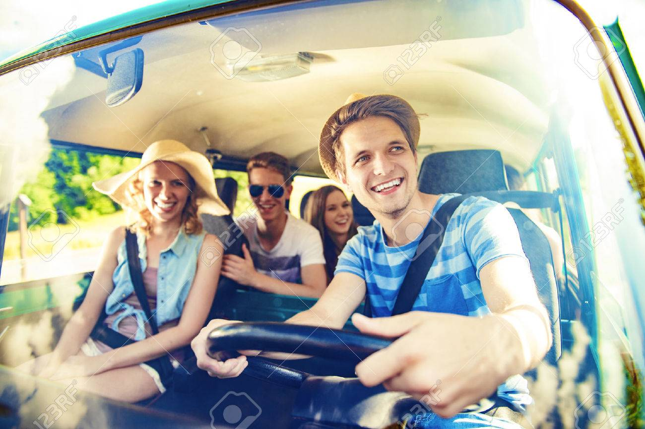 Beautiful young people on a road trip on a summers day - 45742434