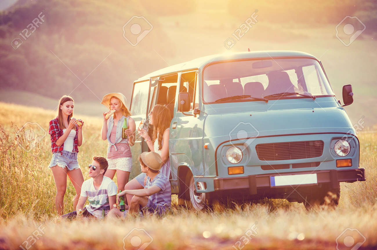 Young hipster friends on road trip on a summers day - 46417570