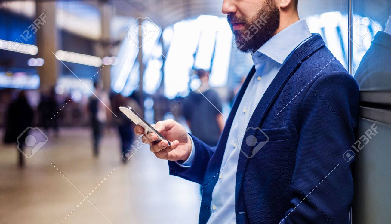 Young handsome businessman with tablet in subway Stock Photo - 47036191