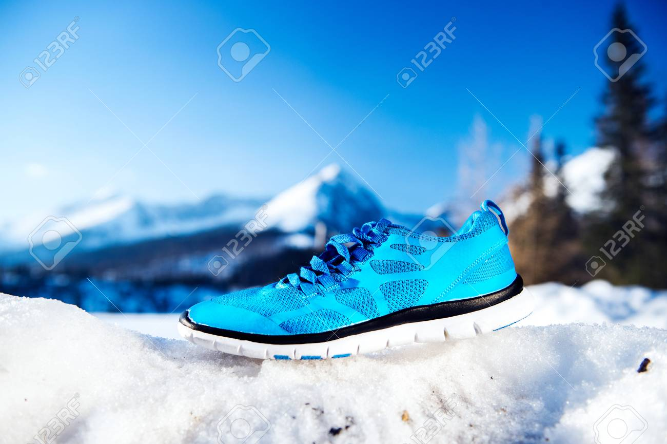 Snow Running Shoes >> Blue Running Shoes Laid Outside On Snow Stock Photo Picture And