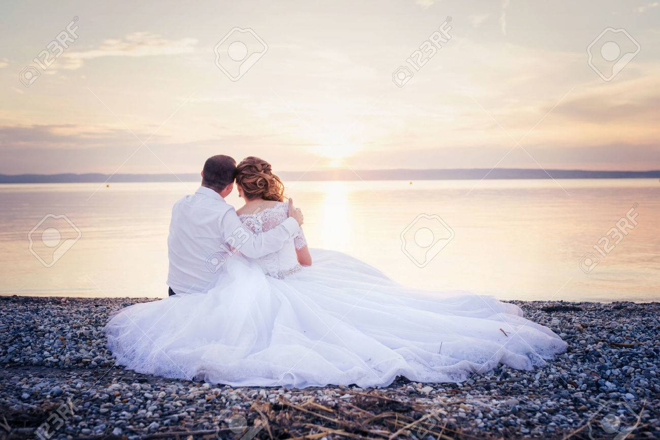 Beautiful young wedding couple at the shore Stock Photo - 47409850