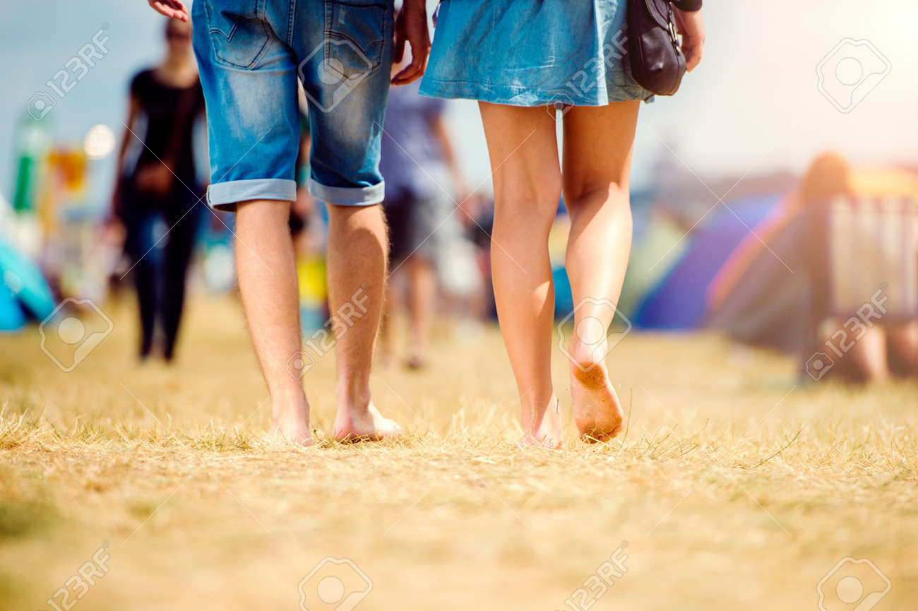 Unrecognizable teenage couple at tent music festival walking sunny summer close up of legs & Unrecognizable Teenage Couple At Tent Music Festival Walking ...