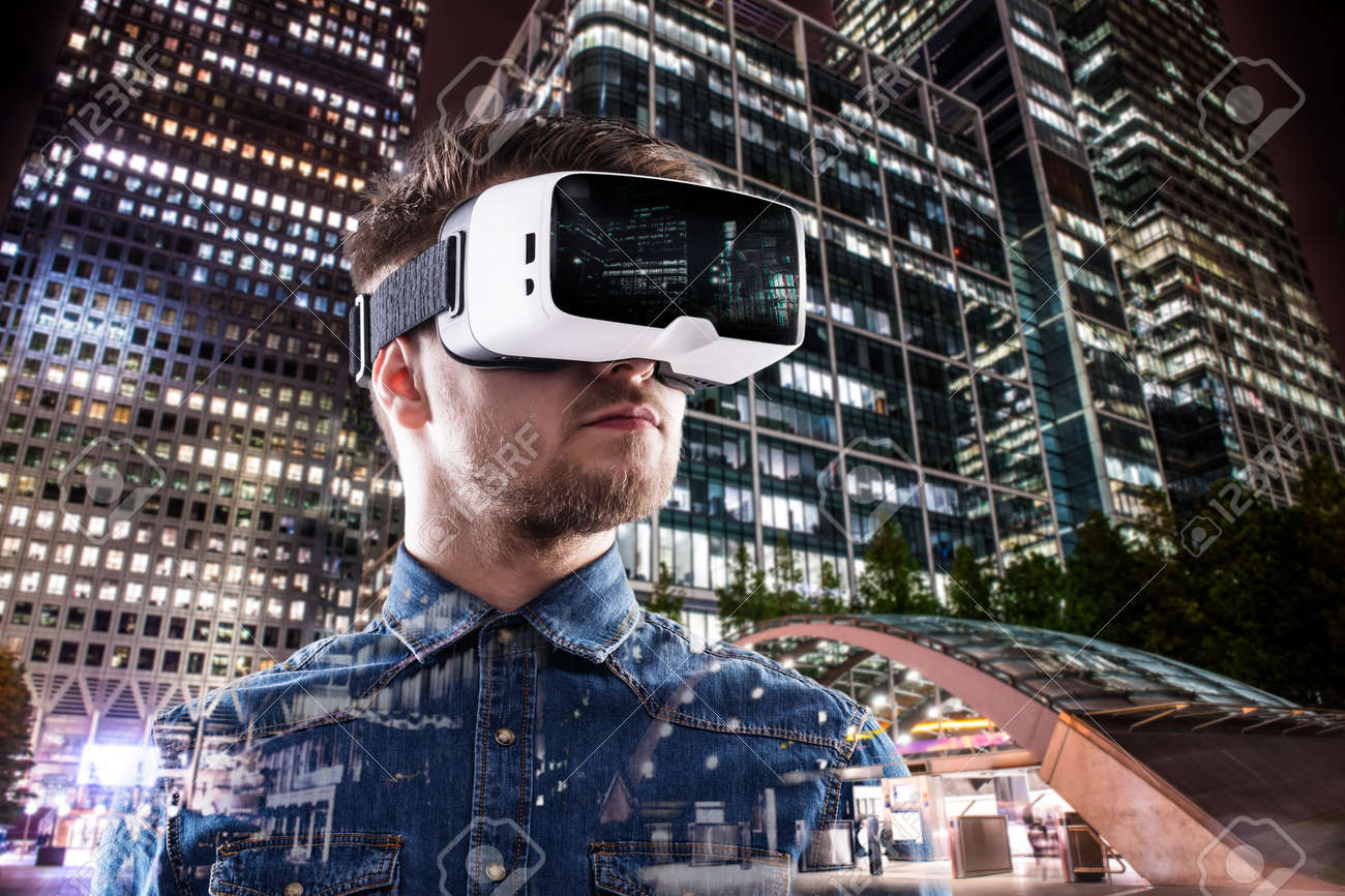 Double exposure of man wearing virtual reality goggles and night city - 53460576