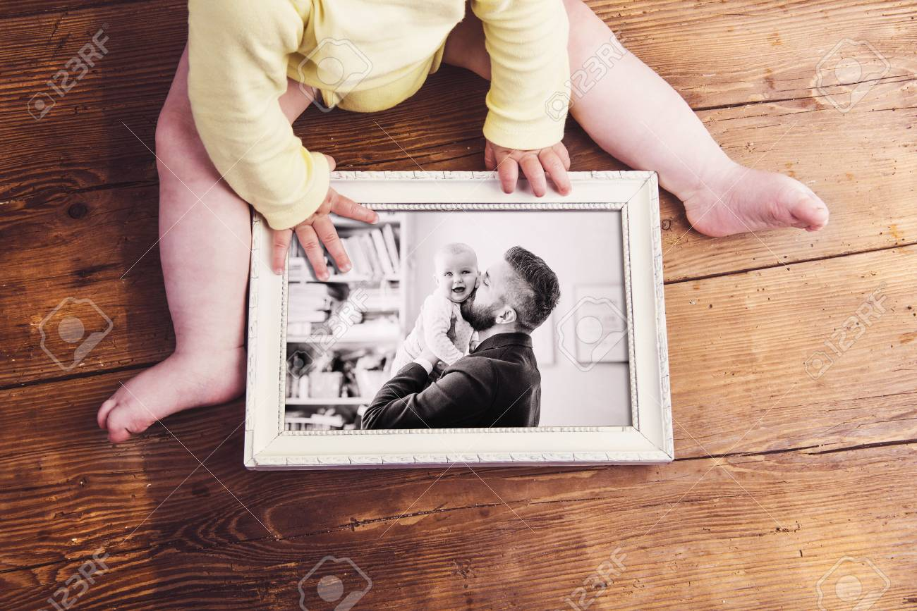 Fathers Day Composition. Unrecognizable Baby Holding A Photo.. Stock ...