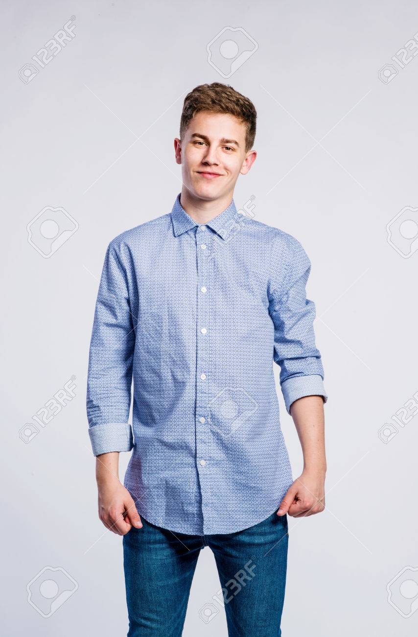 d0ffb2b19aa Stock Photo - Teenage boy in jeans and blue shirt