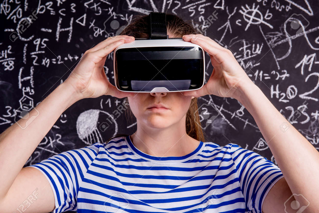 Beautiful woman in blue striped t shirt wearing virtual reality beautiful woman in blue striped t shirt wearing virtual reality goggles student against big biocorpaavc Image collections