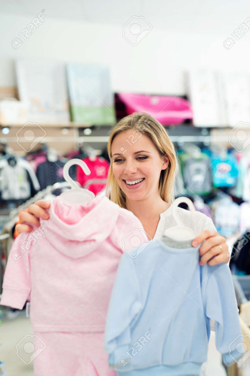 Beautiful Pregnant Woman Shopping Clothes For Her Baby Not Knowing