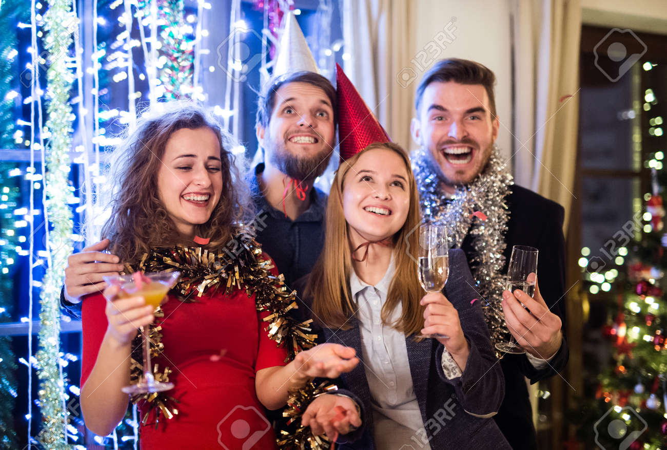 Group Of Friends Celebrating The End Of The Year, Having Party ...
