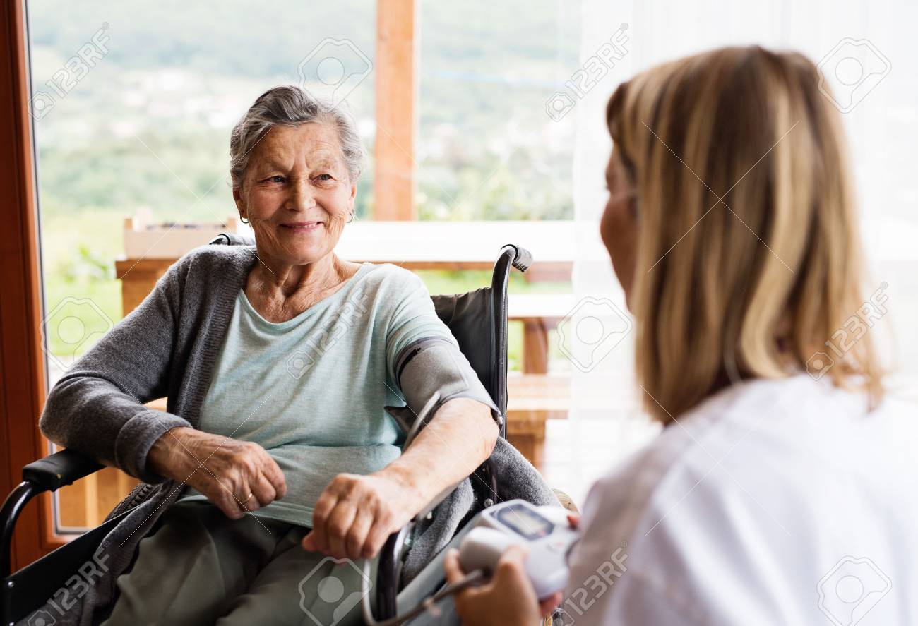 Health visitor and a senior woman during home visit. - 88338209