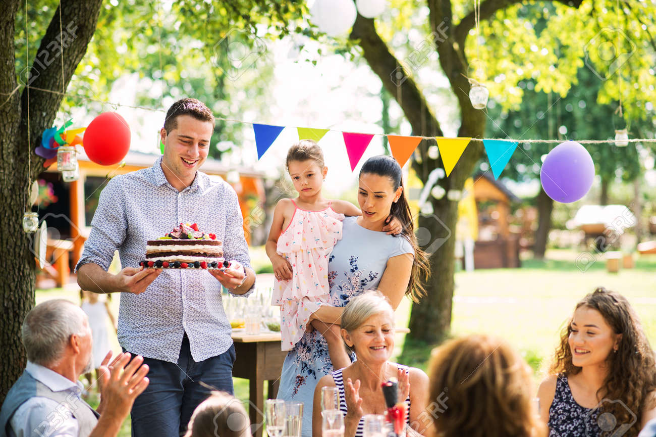 Family celebration or a garden party outside in the backyard. - 102777745