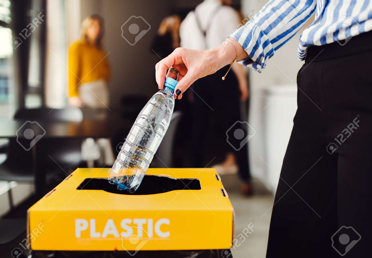 Waste separation and recycling in business office, a midsection. - 122600222