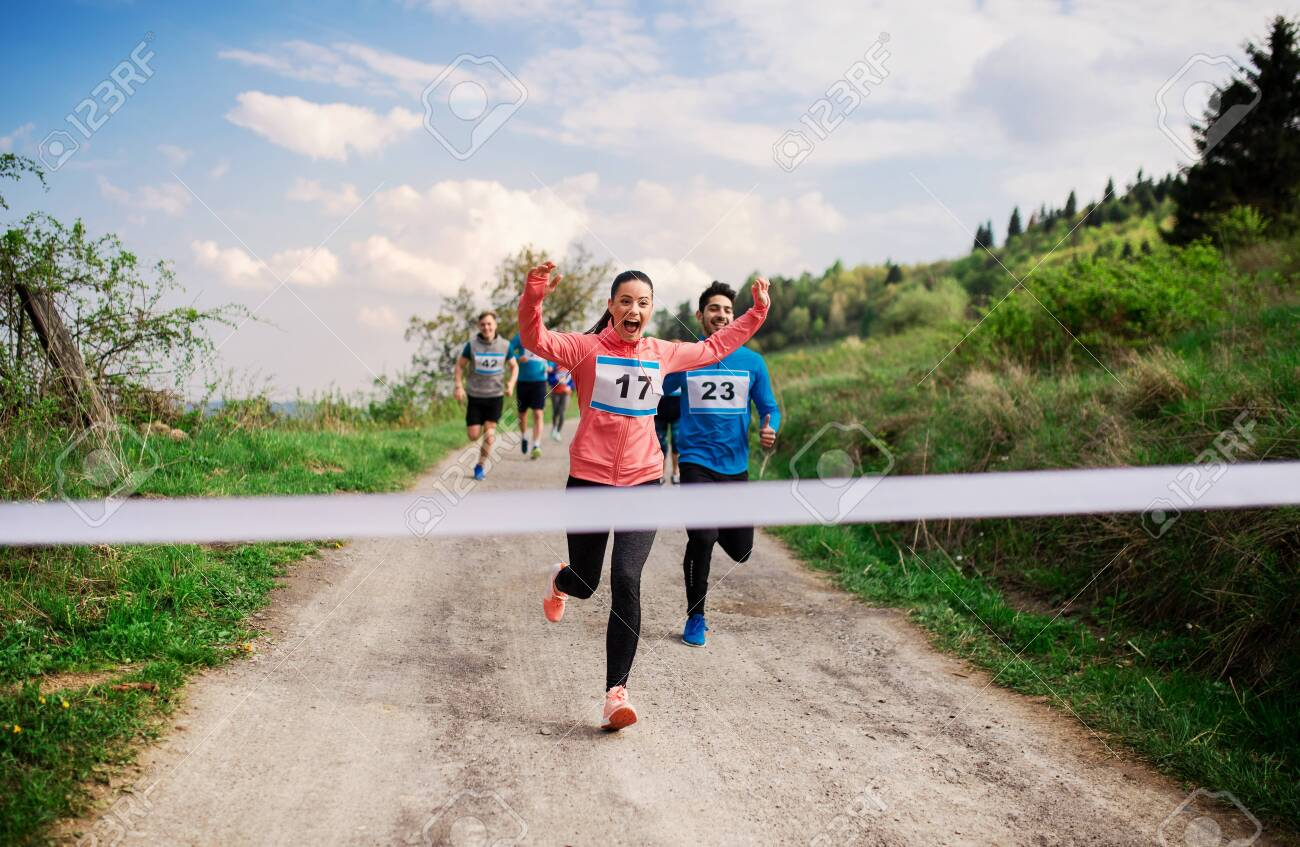 Large group of people running a race competition in nature. - 124975838