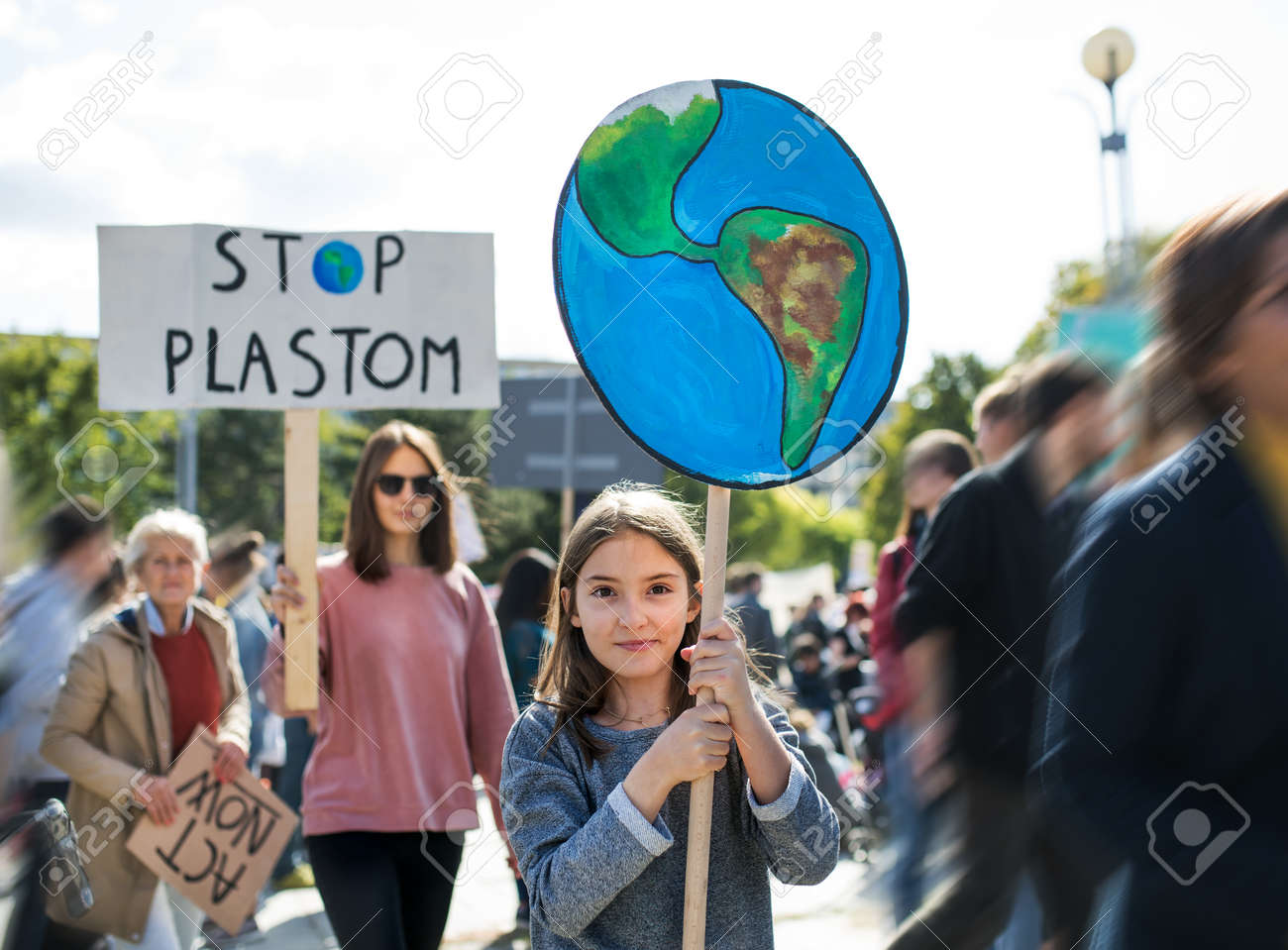 People with placards and posters on global strike for climate change. - 131464224