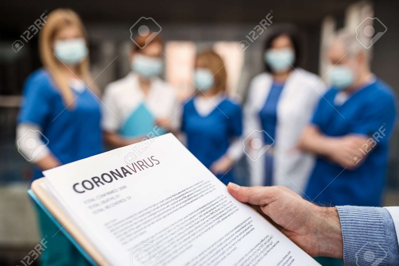 Group of doctors talking about corona virus on conference. - 139930802